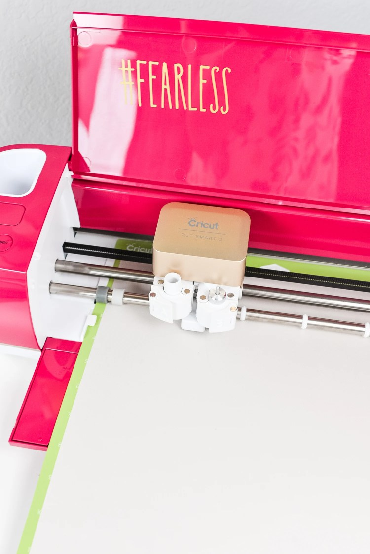 Cricut Explore Air 2 with loaded transfer sheet.