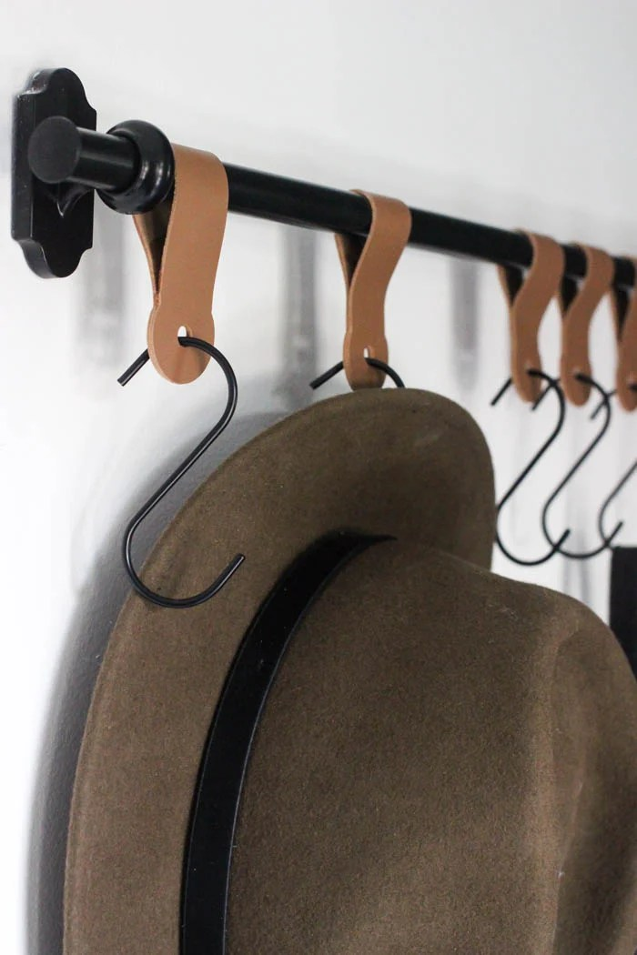 Give your family and guests some place stylish to hang their hats. Use your Cricut to make this modern entry wall hook set up from lovecreatecelebrate.com.
