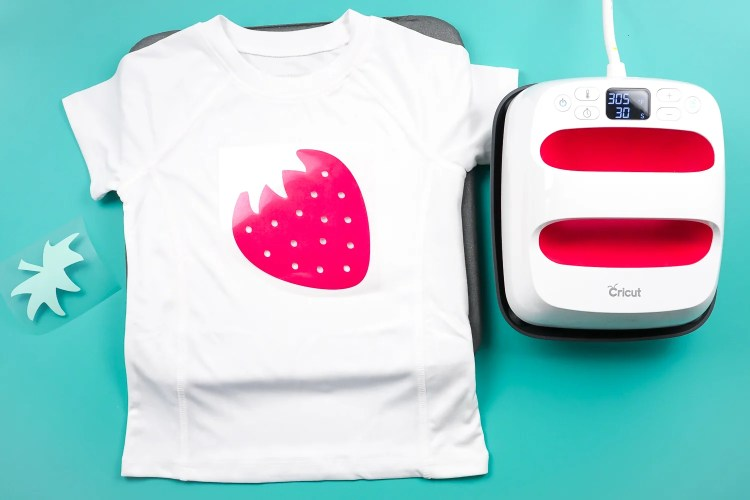 Place your strawberry down on the shirt.