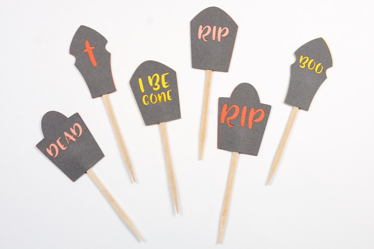 Make any Halloween party more fun with this simple Halloween cake topper —designed to look like a graveyard! These are easy to make with your Cricut, and work well for Halloween cupcakes, too!