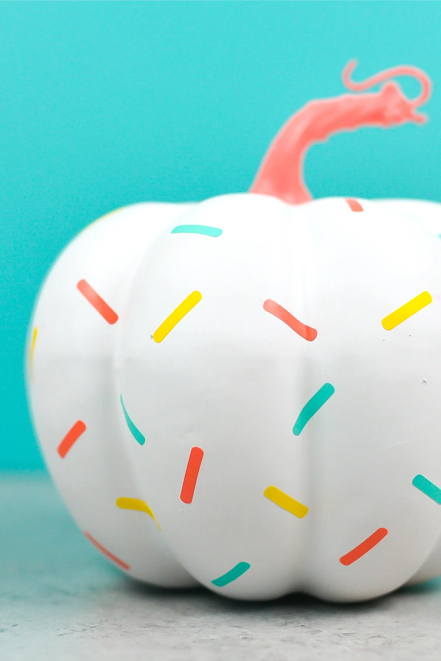 Halloween doesn't have to be scary! This adorable sprinkle DIY pumpkin is a cute addition to your Halloween party decor. Whip it up in less than 15 minutes using vinyl sprinkles cut on your Cricut!
