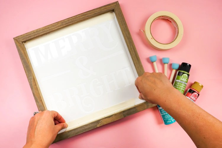 Tape your stencil inside your frame