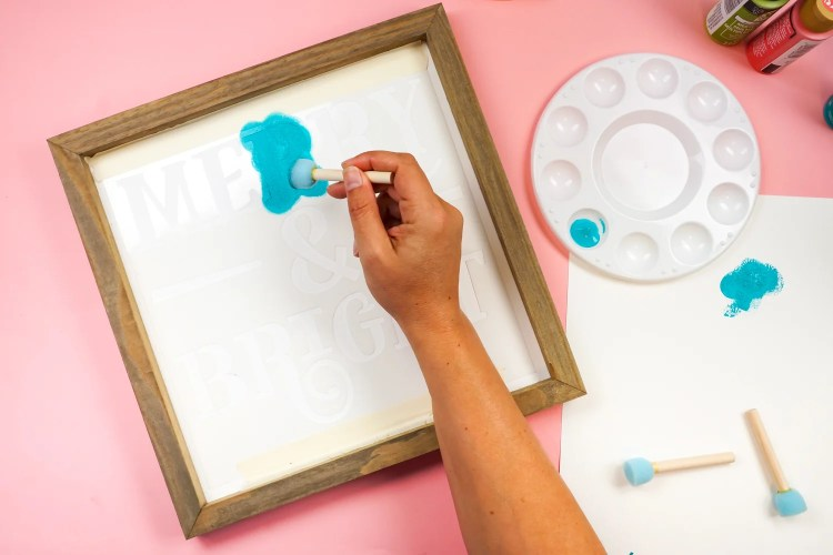 Use a small amount of paint and dab it on your stencil.