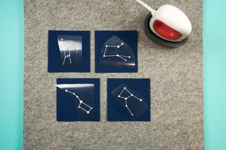 Lay out your fabric squares and place constellation pieces on top of the fabric squares.