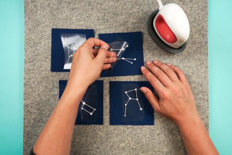 Peel back the plastic carrier sheet.