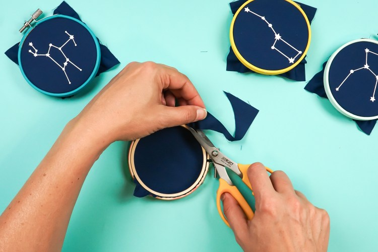 Use sharp scissors to trim the excess fabric off the back.
