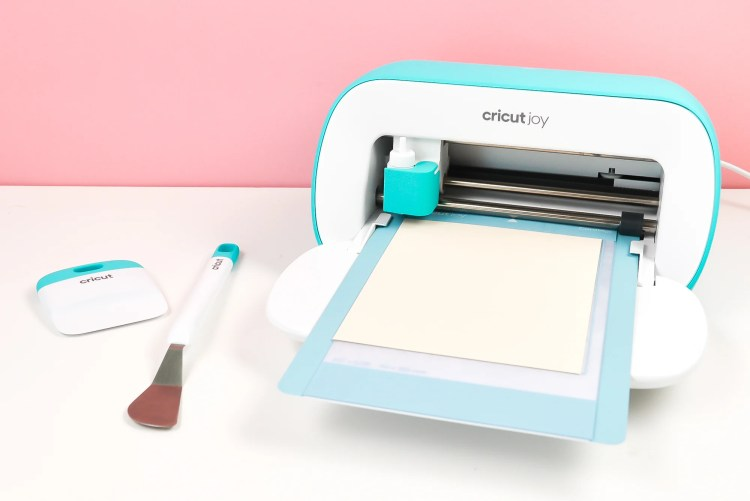 Insert your card into the mat, with the back sandwiched between the two layers of the Cricut Joy Card Mat.