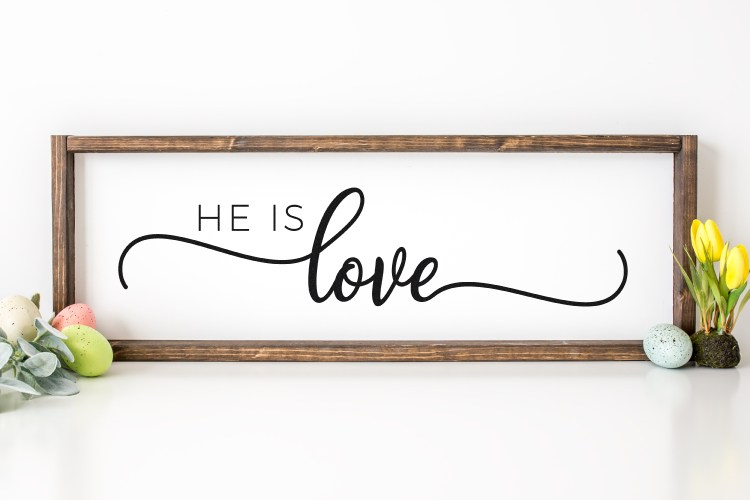 He is Love curt file on a wood sign with easter eggs