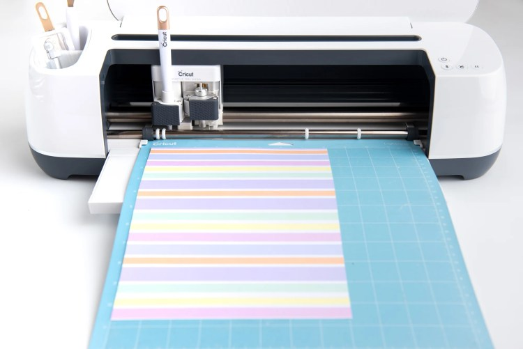 Cardstock being cut on the Cricut Maker