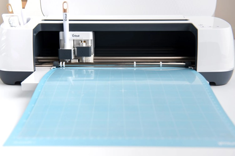 Acetate being cut on the Cricut Maker