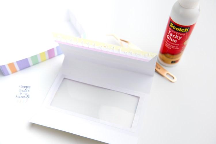 Glue the tab of the sleeve so it creates the sleeve.