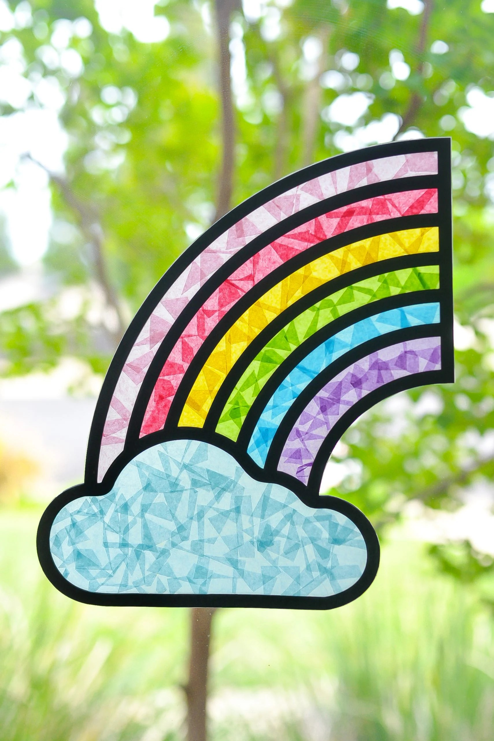 Add a little happiness to your window with this DIY rainbow suncatcher! Cut the frame with your Cricut Explore or Maker, and then use contact paper and tissue paper to create the colorful rainbow!