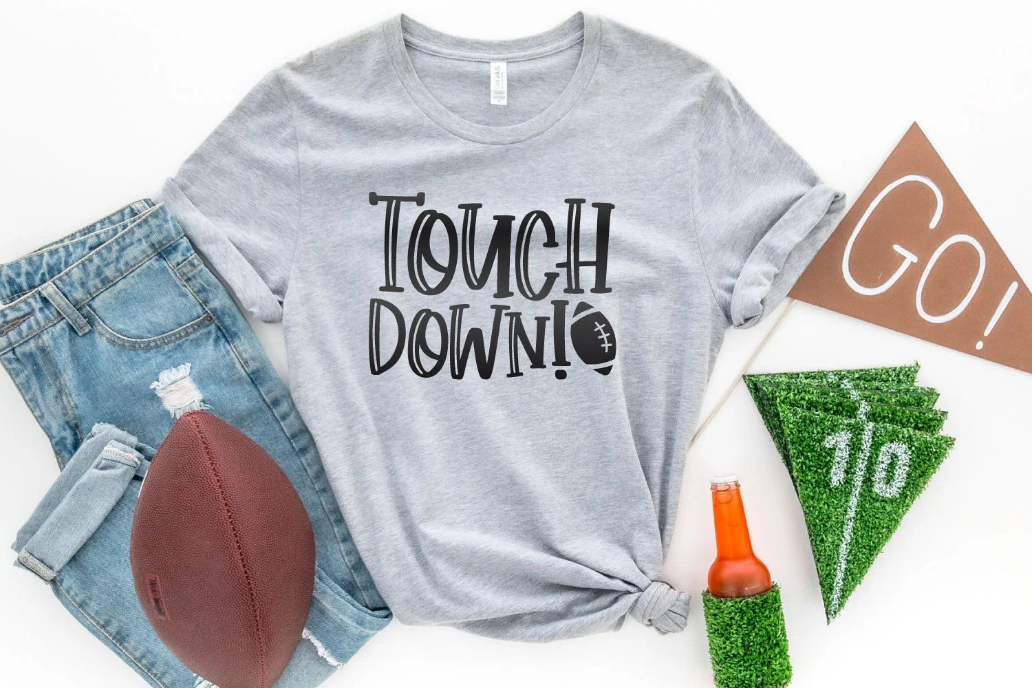 Touchdown SVG on a gray shirt with football accessories