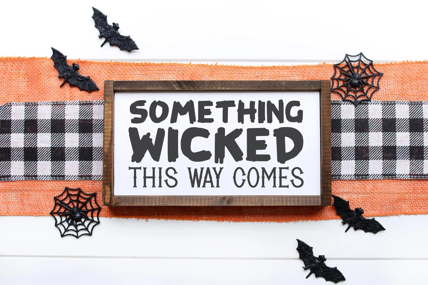 Sign using fonts from this post that reads: Something Wicked This Way Comes