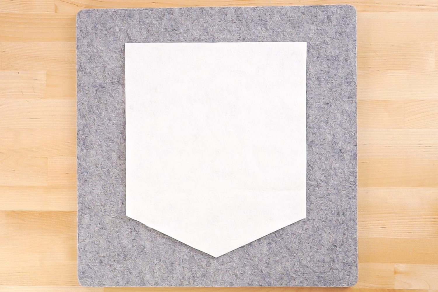 White felt pennant after cutting.