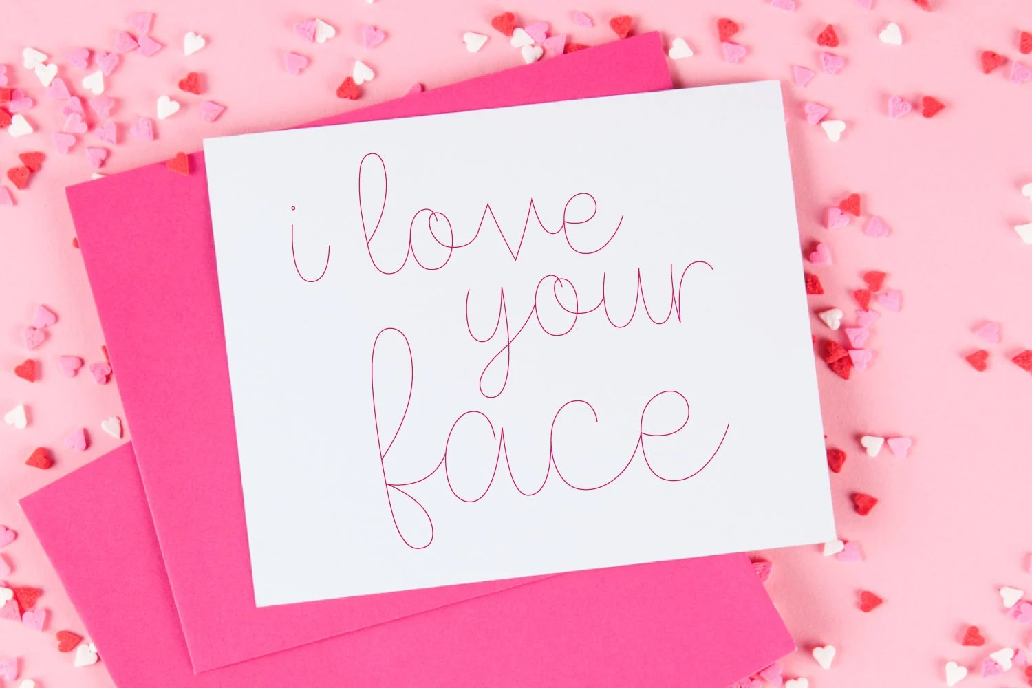"""""""love your face"""" card with pink single-line font foil writing"""