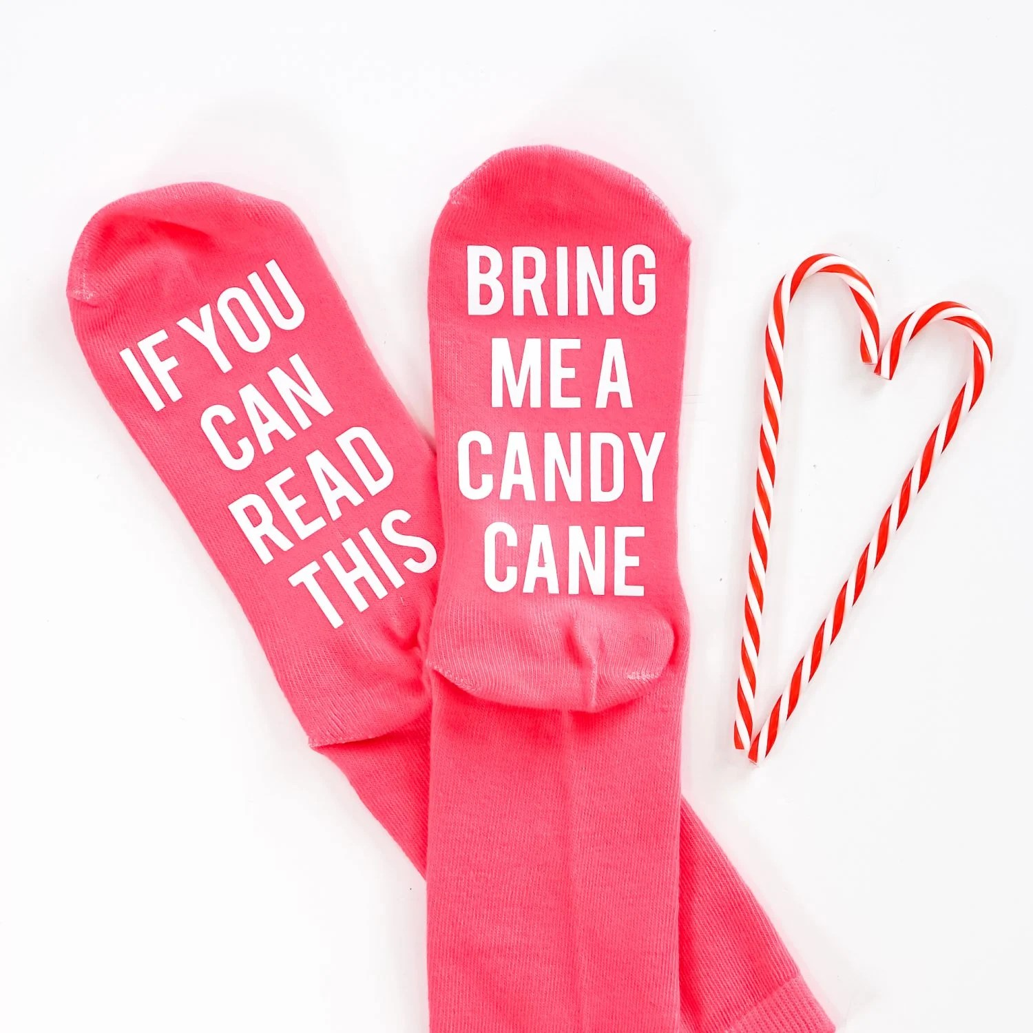 Funny Christmas Socks with candy canes on a white background.