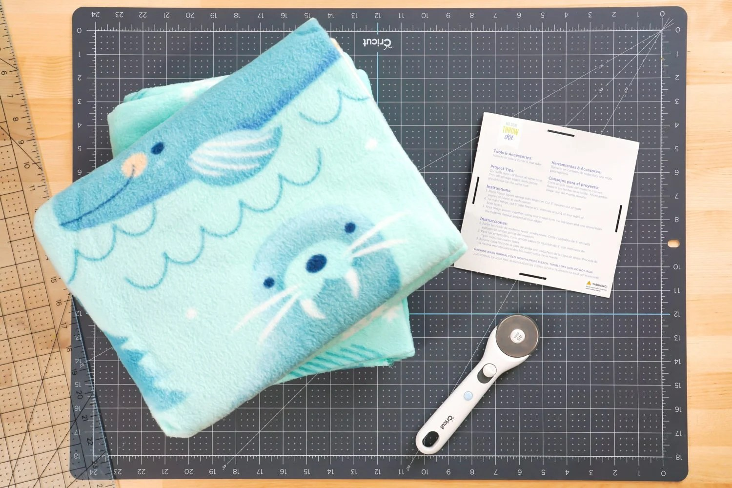 Fleece blanket kit with rotary cutter and instructions from tag