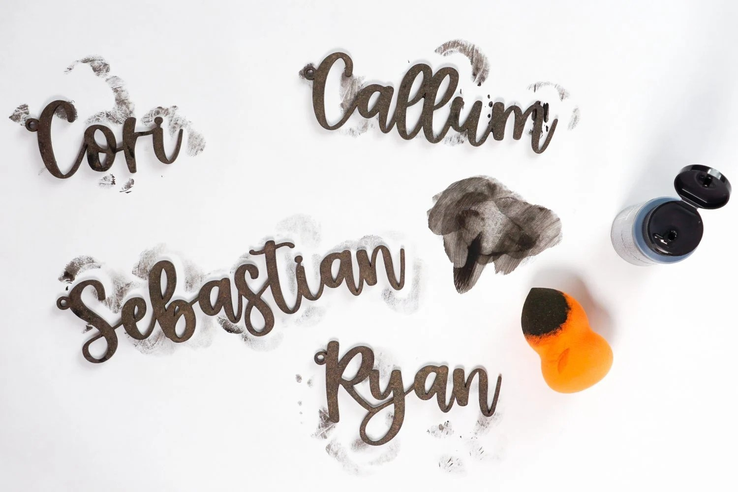 Painting names with makeup sponge