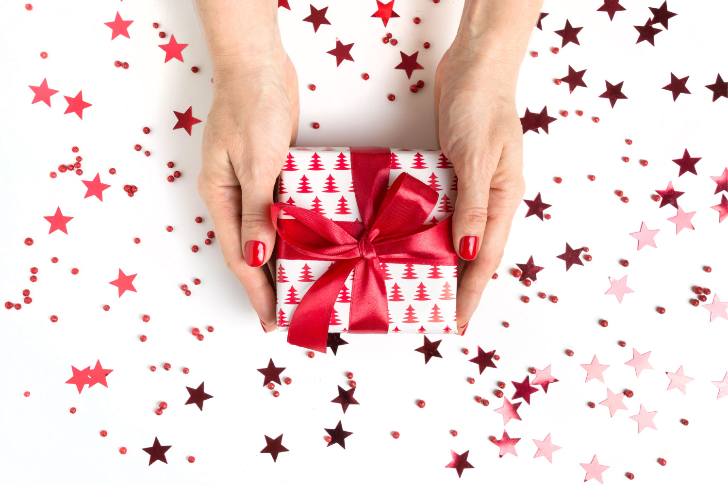 Hands holding present wrapped for Christmas