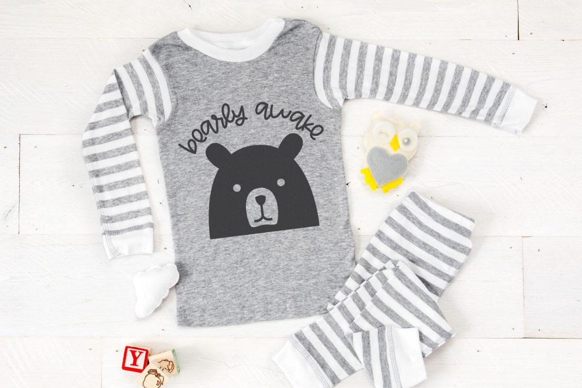 Bearly Awake SVG on gray pajamas with baby toys