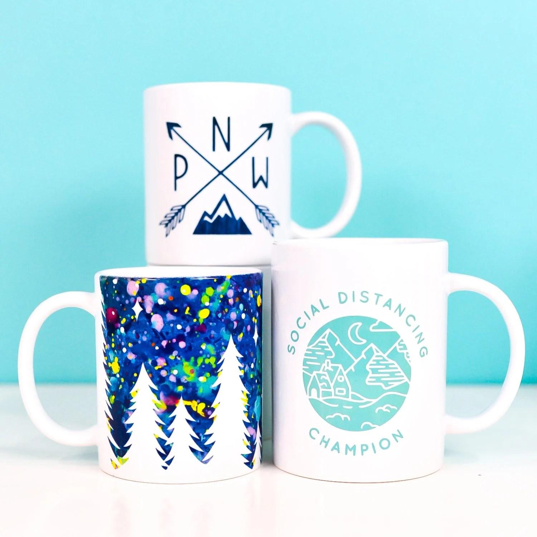 Three finished mugs using the Cricut Mug Press