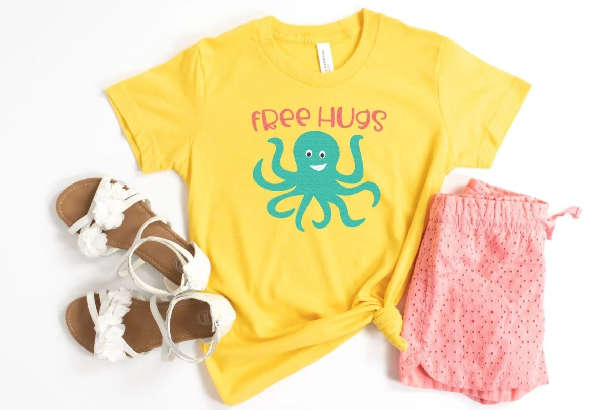 Free Hugs SVG on Yellow Shirt with Pink shorts and sandals