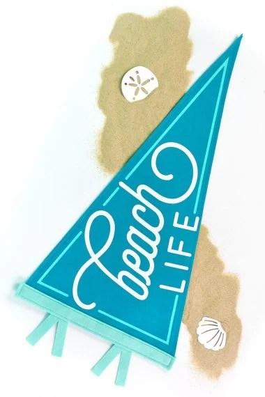 Beach Life Pennant on white background with sand