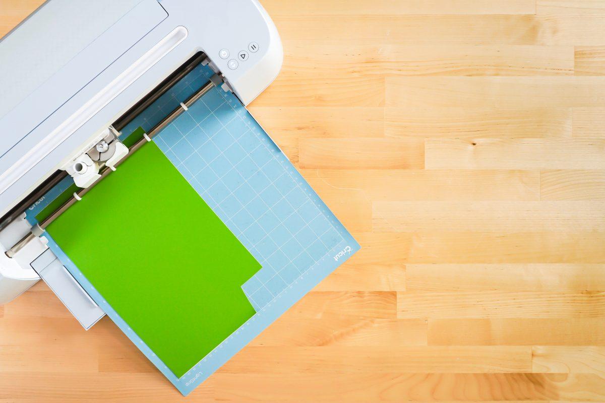 Cricut Maker cutting green vinyl