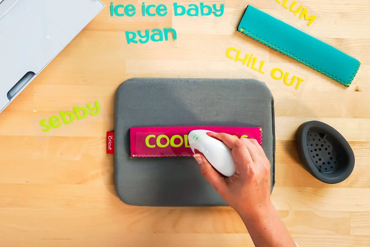 """Hand using EasyPress Mini to adhere the """"cool vibes"""" decal."""