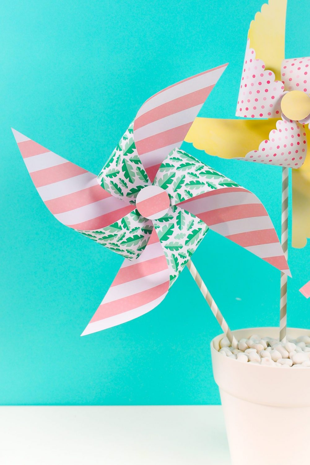 Final paper pinwheels on a teal background