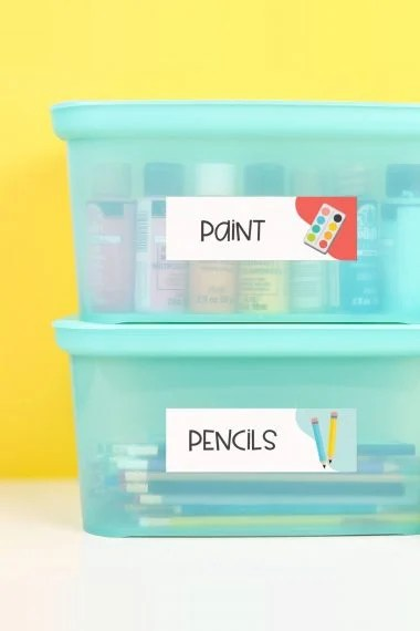 School supplies in boxes with classroom labels.