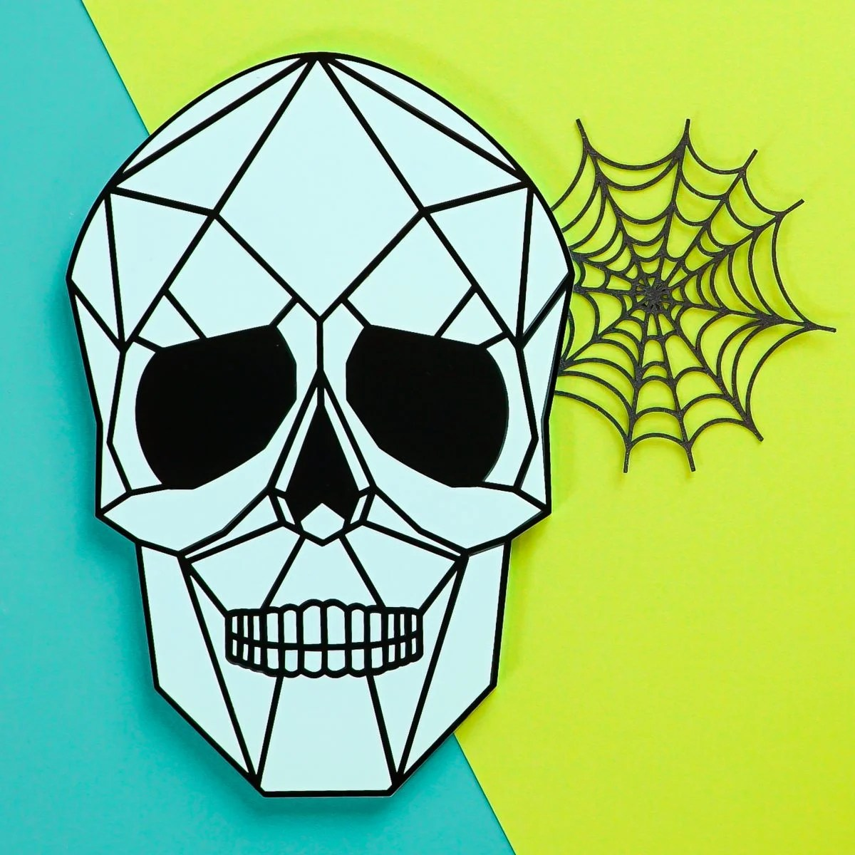 Light blue and black skull on teal and green background