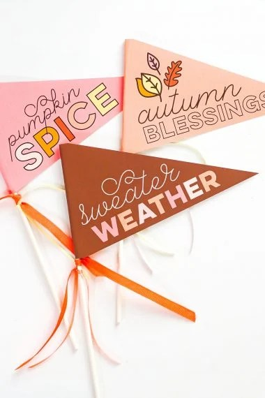 Three completed fall pennants: pumpkin spice, sweater weather, autumn blessings