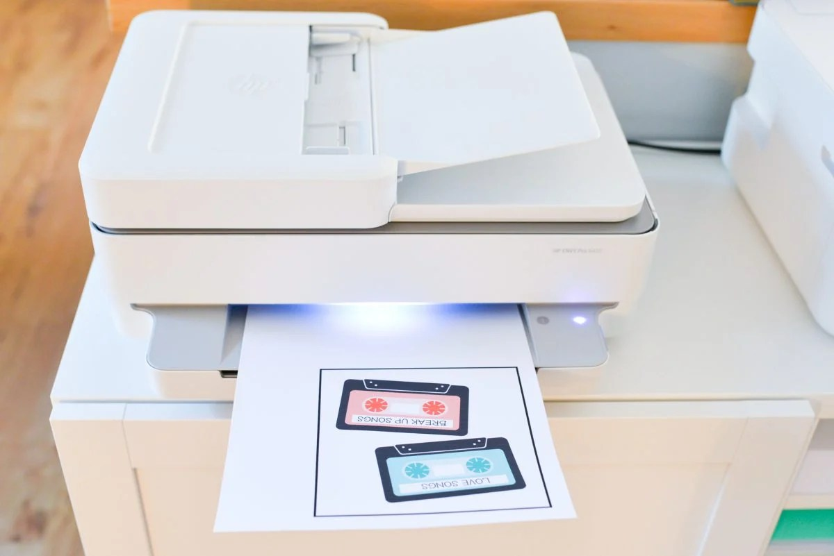 HP Envy printer with printed mix tape image in tray.