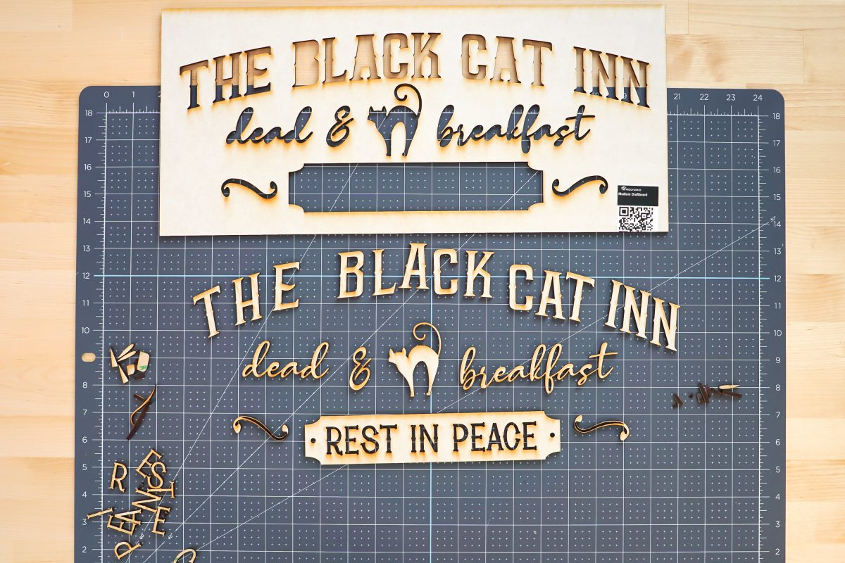 Vintage halloween sign pieces removed from frame.
