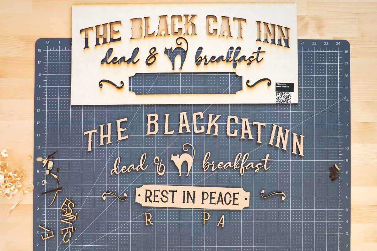 Vintage Halloween Sign pieces with removed mask.