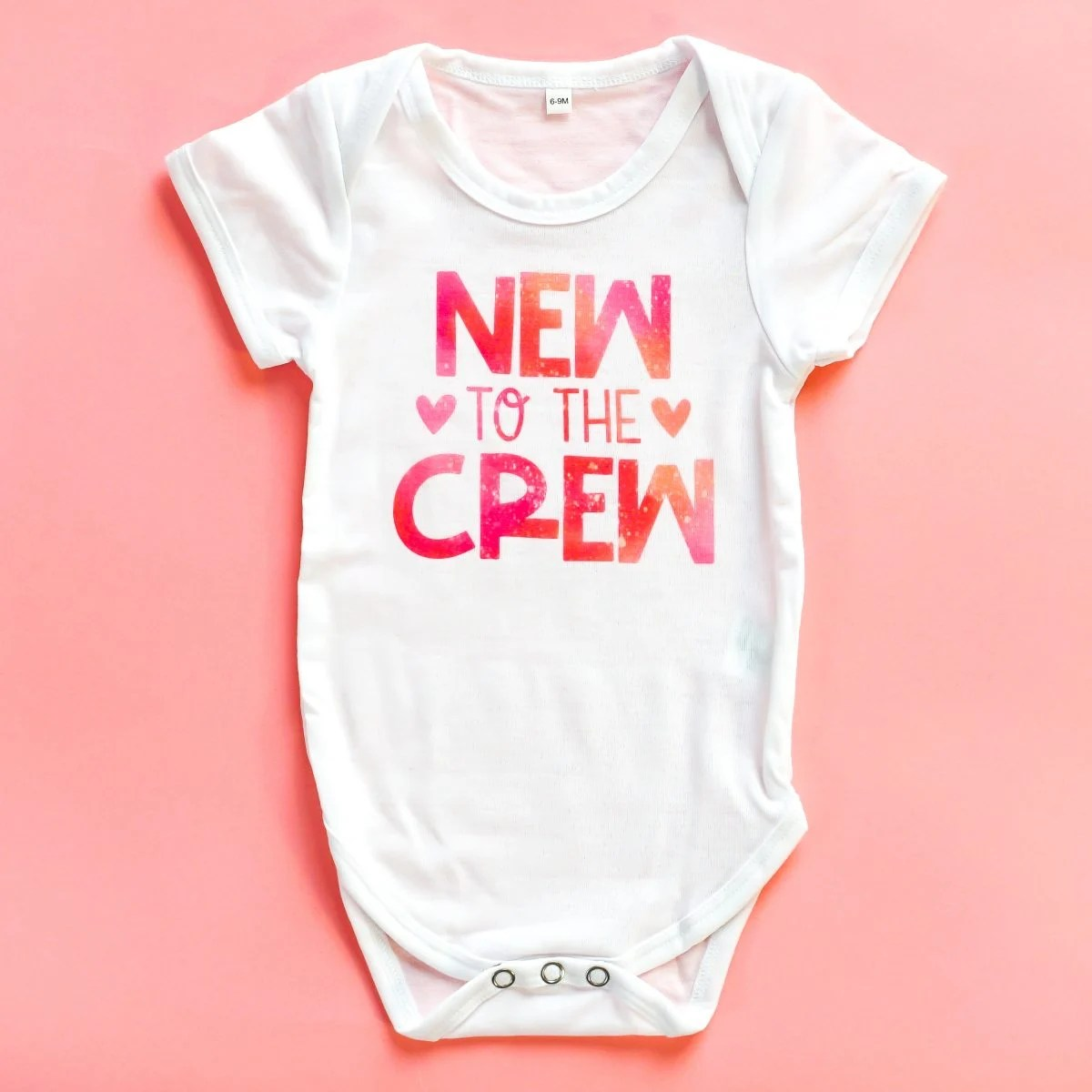 """""""New to the Crew"""" onesie using Infusible Ink."""