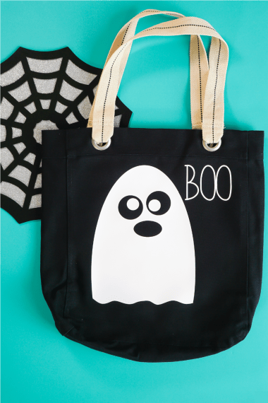 Finished Ghost Trick or Treat bag on teal background