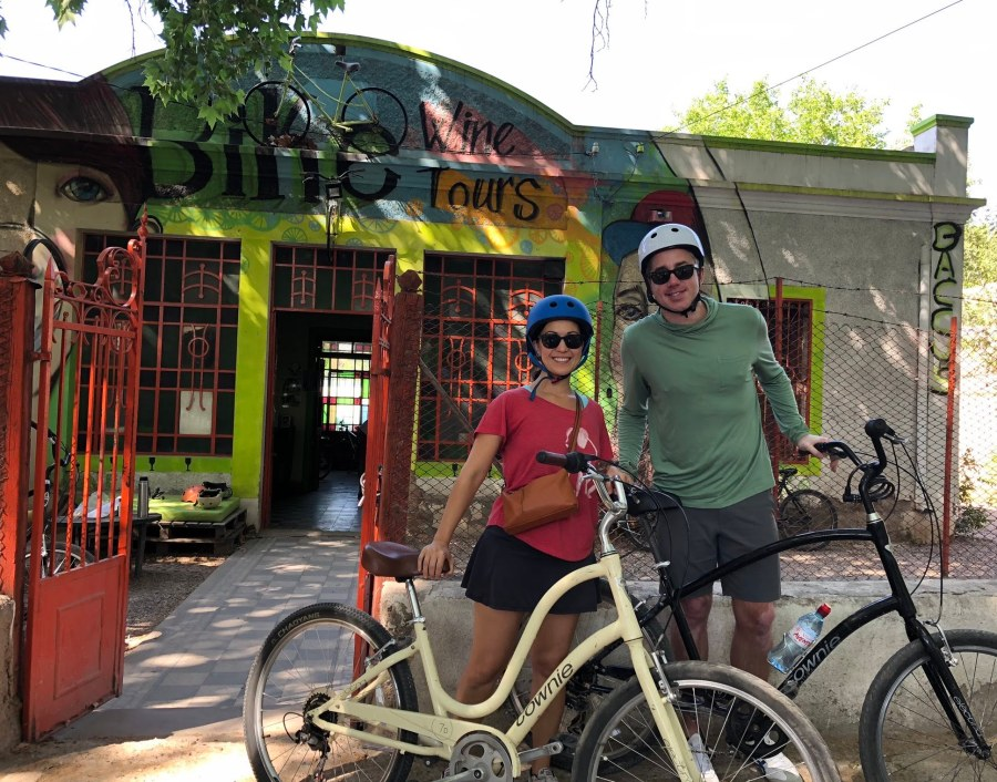posing with our bikes outside of Baccus Biking in Lujan de Cuyo, Mendoza