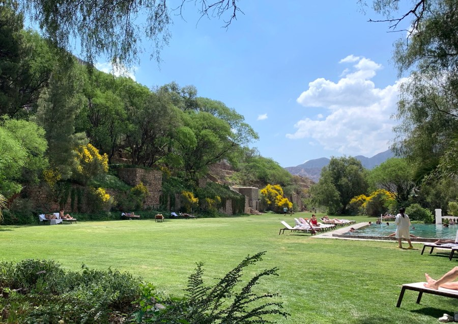 view of the pool and well kept grounds at Termas Cacheuta spa