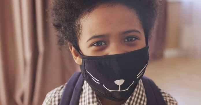 Boy wears mask in fight against COVID-19