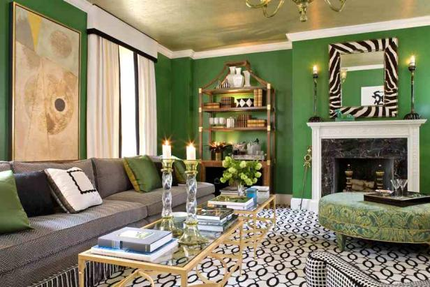 Green Walls In a Living Room With Black and White Details.