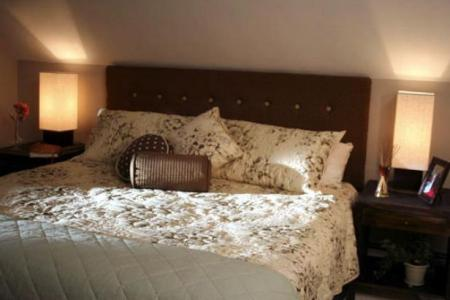 How to Transform Your Bedroom With a Floating Headboard   HGTV hdswt404 2cb HeadBoard after3