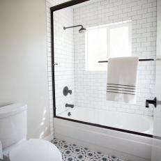 Midcentury Modern Bathroom Photos   HGTV Black and White Bathroom With Patterned Floor Tile and Subway Tile Glass  Door Shower