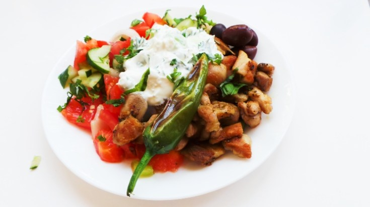 Mediterranean Chicken Bowls - an easy and healthy dinner that comes with a very simple meal prep option. Filled with tzatziki, tomato cucumber salad, olives this delicious chicken recipe is low carb, gluten-free and keto, but if you're not doing a special diet, you can serve this with rice, bread or quinoa.