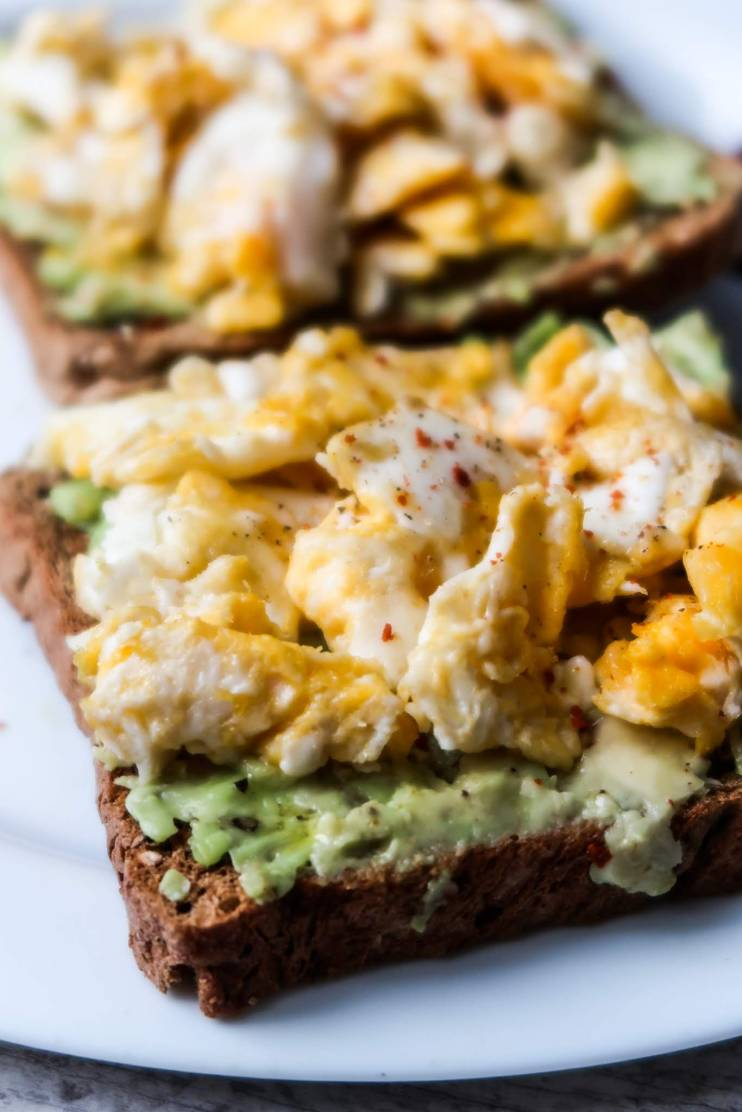 10-Minute avocado toast with egg! This egg and avocado toast recipe is a delicious, easy healthy savory breakfast that you'll want to make every day. Also a great simple healthy lunch idea with a small salad on the side!