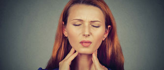 sick-young-woman-having-pain-in-her-throat