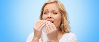 unhappy-woman-with-napkin-sneezing