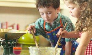 Children baking together in kitchen